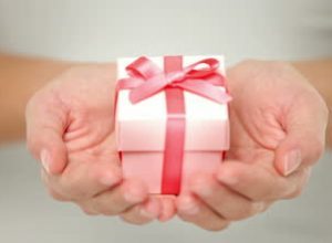 stock-footage-gift-closeup-red-present-of-gift-in-closeup-in-woman-hand